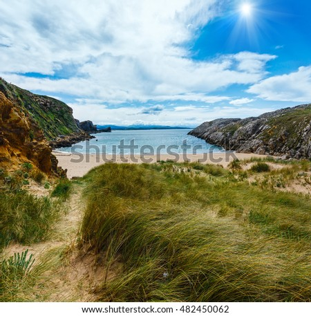 Sunshiny sandy beach (Spain) Atlantic Ocean coastline landscape.