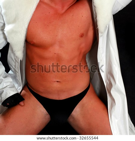 Suntanned man's body in a white raincoat and black pants, close up