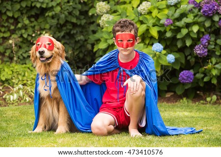 Super boy and super dog in cape and mask
