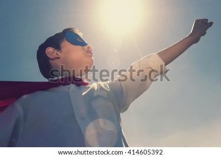 Super boy concept. Retro toned image with selective focus - stock photo