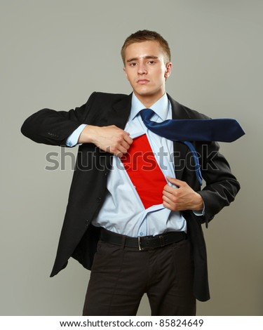 Super businessman isolated on grey - stock photo