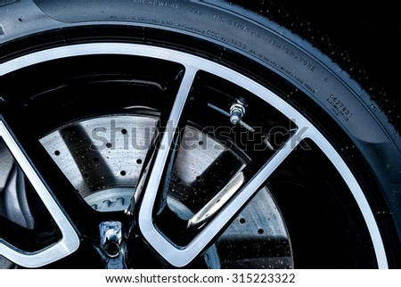 Super car disc brake. Car wheels. steel alloy car disks background template for design work.  car rims isolated on black background. car alloy wheel. Close-up shot of a car's brake disc. - stock photo