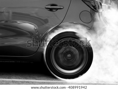 Super car wheel drifting and smoking on track with black and White Color - stock photo