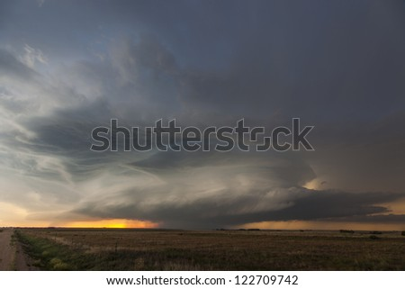 Super-cell thunderstorm at sunset - stock photo