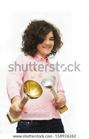 Super champion. Ten year old girl with two winner cup. Isolated on white. - stock photo