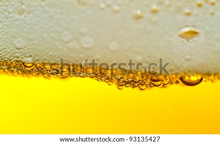 Super close up of the bubbles in beer with plenty of copy space.