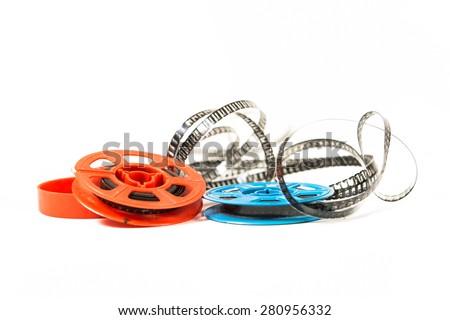 Super 8 film in two colored bobbins - stock photo