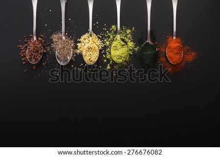 Super food health food selection in spoon - stock photo