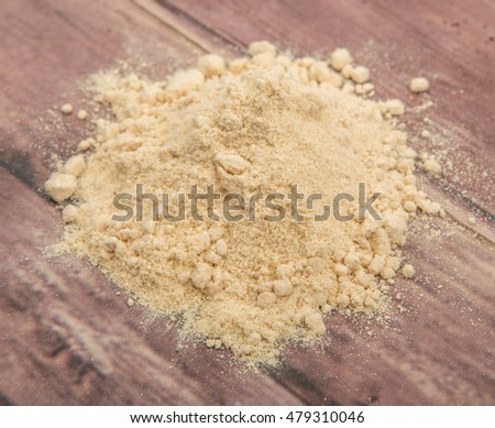 Super food maca powder over wooden background