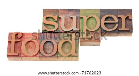 super food- words in vintage wooden letterpress printing block, stained by color inks, isolated o n white