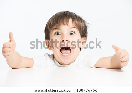 Super happy hyperactive child screaming with exciment      - stock photo