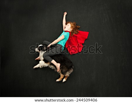 Super hero and her flying dog - stock photo
