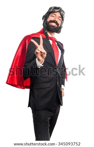 Super hero businessman doing victory gesture