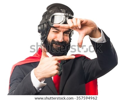 Super hero businessman focusing with his fingers - stock photo