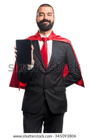 Super hero businessman holding a tablet