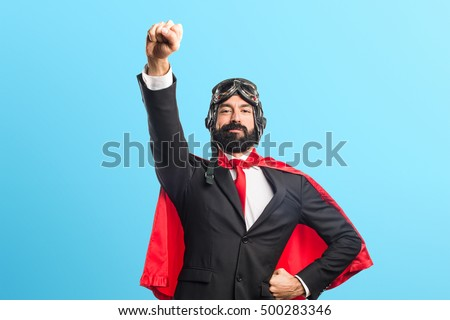 Super hero businessman over colorful backgound