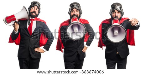 Super hero businessman shouting by megaphone - stock photo