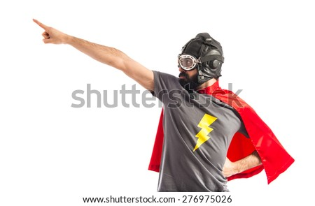 Super hero pointing to the lateral  - stock photo