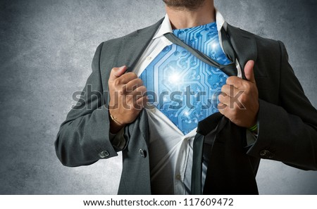 Super hero with computer circuit - stock photo
