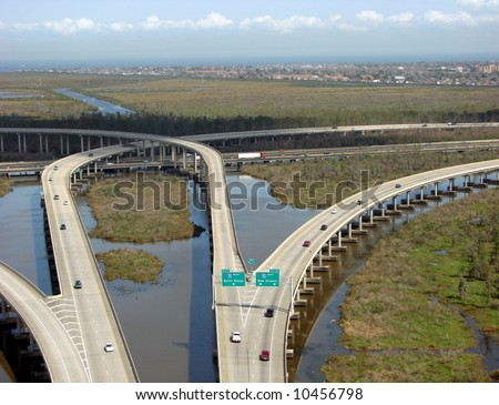 Super highway interstate road interchange bridge crossing Louisiana Bayou Swamp over wetland and marshes near New Orleans - stock photo
