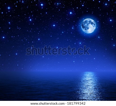 super moon in starry sky on sea  - stock photo