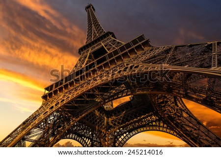 Super wide shot of Eiffel Tower under dramatic sunset, Paris, France - stock photo