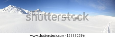 Superb panoramic view of M. Viso (3841 m) mountain range in a winter scenery during a back country ski ascent. - stock photo
