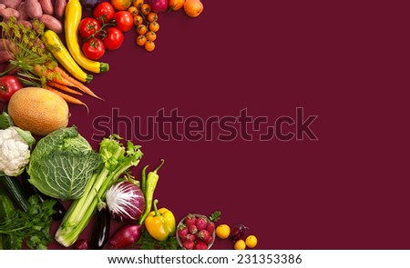 Superfood background / studio photo of different fruits and vegetables on red backdrop  - stock photo