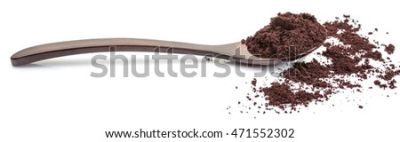 Superfood dried acai berry powder in wooden spoon over white background