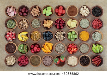 Superfood selection for cold and flu remedy to boost immune system. High in antioxidants, anthocyanins, vitamins and minerals. - stock photo