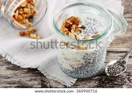 Superfoods concept : overnight chia pudding with homemade granola and honey. Healthy eating. Selective focus. - stock photo