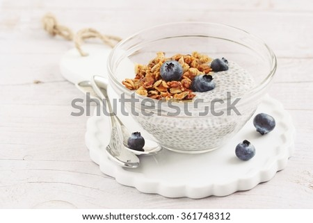 Superfoods concept : overnight chia pudding with homemade granola,fresh berries and honey. Healthy eating. Selective focus. - stock photo