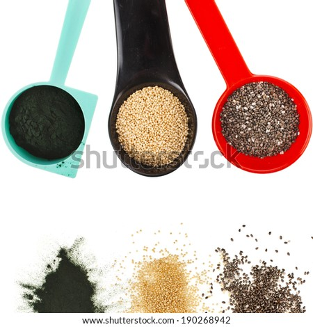 superfoods heap pile collection close up in colorful scoop  top view surface  isolated on white background - stock photo