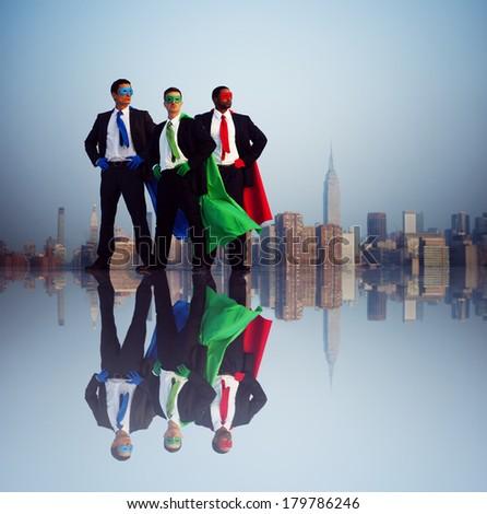 Superhero Businessmen at New York City Skyline - stock photo