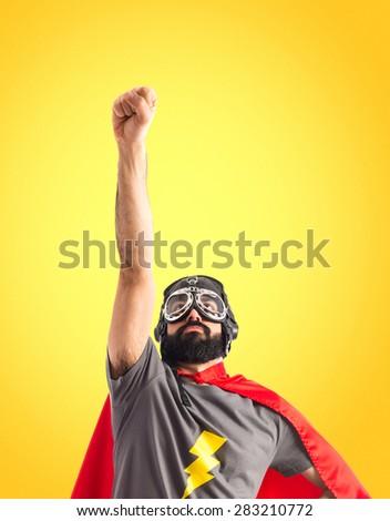 Superhero doing fly gesture - stock photo