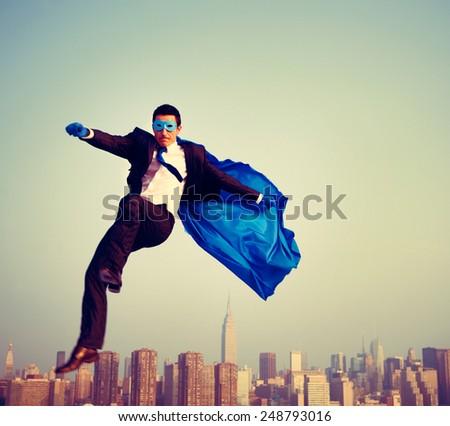 Superhero Energetic Businessman Cityscape Concept - stock photo