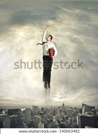 superhero flying over the city - stock photo