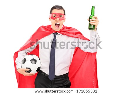 Superhero holding a football and cheering isolated on white background - stock photo
