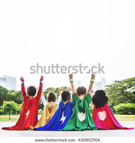 Superhero Kids Aspiration Imagination Playful Fun Concept - stock photo
