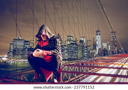 superhero looking after the city. fantasy concept about justice - stock photo