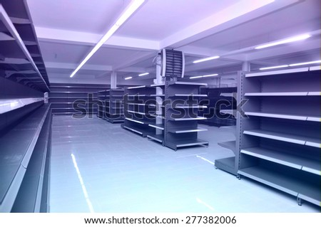 Supermarket shelves in perspective.  - stock photo