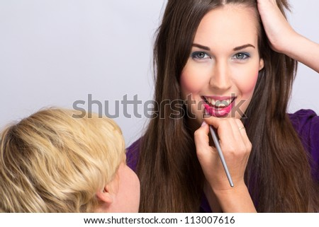 Supermodel and makeup artist - stock photo