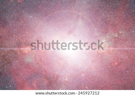 Supernova in the center of a distant galaxy. - stock photo