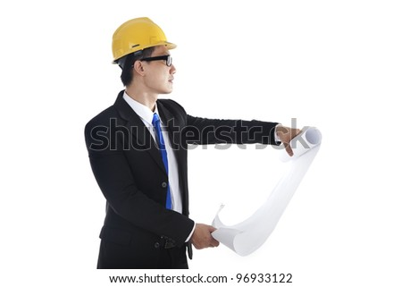 Supervisor checking the blueprint at workplace, isolated on white - stock photo