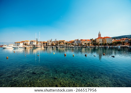 Supetar city in Brac island, Croatia. View from the sea. - stock photo