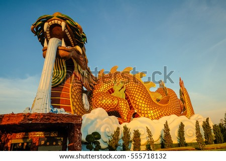 SUPHAN BURI, THAILAND - JANUARY 11: Large dragon sculpture in the park. Public places and tourist attractions on JANUARY 11, 2016 in Suphan Buri, Thailand.