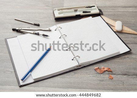 supplies for pencil drawing in school on a wooden table
