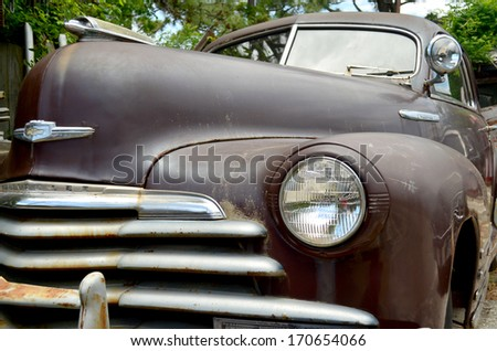SUPPLY, NC USA- MAY 23, 2013 - Closeup of the front of a 1948 Chevrolet Fleetline Aerosedan Coupe as it sits in front of Fort Apache in Supply, NC on May 23, 2013 during the seasons opening day. - stock photo