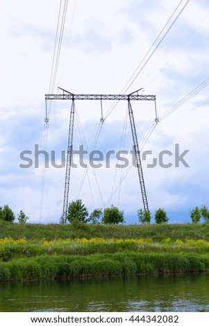 Support high-voltage power transmission lines and five hundred thousand volts (500) leading across the river. Unified Energy System of Russia.
