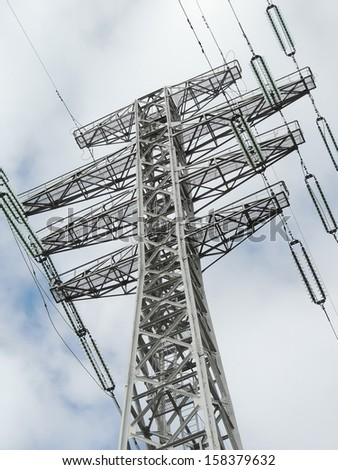 support high-voltage wires against the sky - stock photo